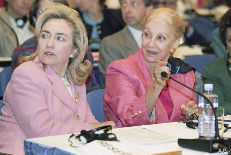 FILE - First lady Hillary Clinton and Leia Maria Boutros Boutros-Ghali, wife of U.N. Secretary General Boutros Boutros-Ghali, at a panel discussion on women's health and security at the U.N. Women's Conference in Beijing, Sept. 5, 1995.