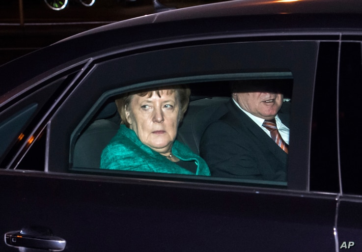 Chairwoman of the Christian Democratic Union and German Chancellor Angela Merkel and Bavaria's Prime Minister Horst Seehofer of Christian Social Union, arrive for a meeting with German President Frank-Walter Steinmeier at Bellevue Palace in Berlin, G...