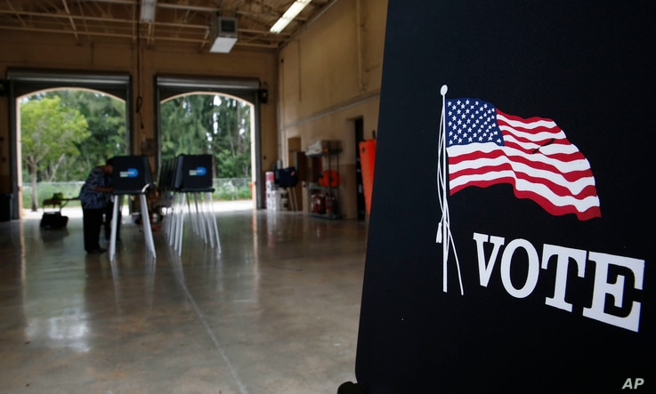 Voters cast their ballots at the Miami-Dade County Palm Springs North Fire Station, during the Florida primary election, Aug. 28, 2018, in Miami.
