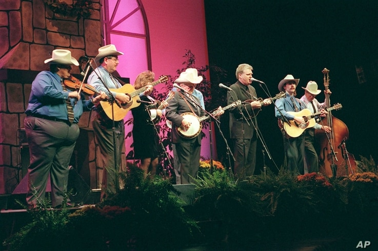 FILE - Ricky Skaggs and Rhonda Vincent perform with Ralph Stanley and the Clinch Mountain Boys Thursday, Oct. 22, 1998, to begin the ninth International Bluegrass Music Association Awards Show at the Kentucky Center for the Arts in Louisville.