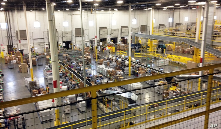 FILE - One of Amazon's distribution centers in Tracy, Calif., is seen during a tour, Nov. 30, 2014.