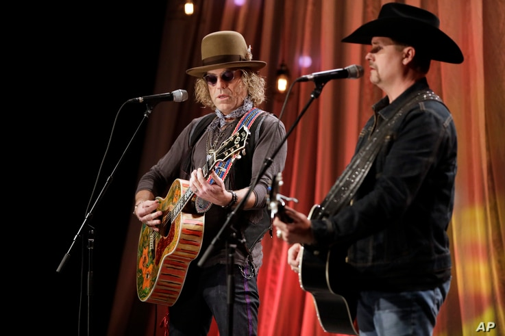FILE - Kenny Alphin, left, and John Rich, right, of the country music duo Big & Rich, perform a song during a taping for Dolly Parton's Smoky Mountain Rise Telethon in Nashville, Tennessee, Dec. 13, 2016.