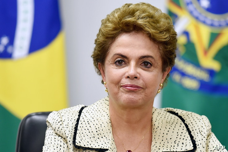 Brazilian President Dilma Rousseff gestures during a meeting with representatives of the National Council of Christian Churches of Brazil (CONIC) at the Planalto Palace in Brasilia, Feb. 10, 2016.