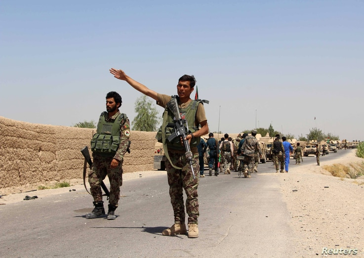 An Afghan National Army (ANA) soldier gestures as they arrive in Nad Ali district of Helmand province, southern Afghanistan, Aug. 10, 2016.