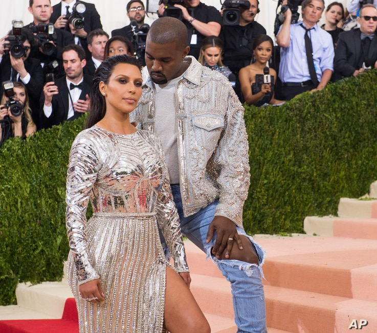 """Kim Kardashian and Kanye West arrive at The Metropolitan Museum of Art Costume Institute Benefit Gala, celebrating the opening of """"Manus x Machina: Fashion in an Age of Technology"""" on May 2, 2016, in New York."""