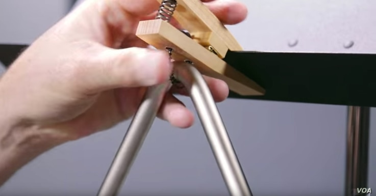 The Grover triangle clip clamps the instrument to a music stand and suspends it while being played so it resonates.