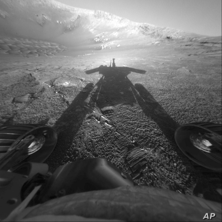 FILE - This July 26, 2004, photo made available by NASA shows the shadow of the Mars rover Opportunity as it traveled farther into Endurance Crater in the Meridiani Planum region of Mars.