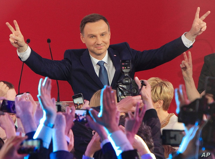 Opposition candidate Andrzej Duda celebrates with supporters his victory, as first exit polls in the presidential runoff voting are announced in Warsaw, Poland, May 24, 2015.