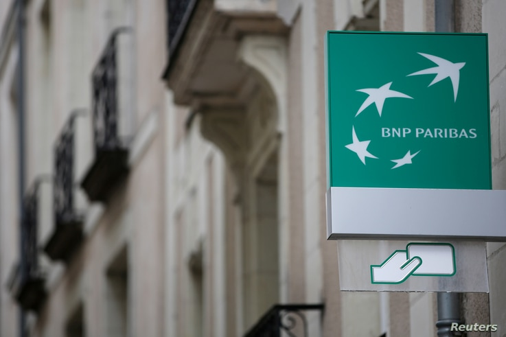 FILE - The logo of BNP Paribas bank is pictured on an office building in Nantes, France, July 21, 2017.