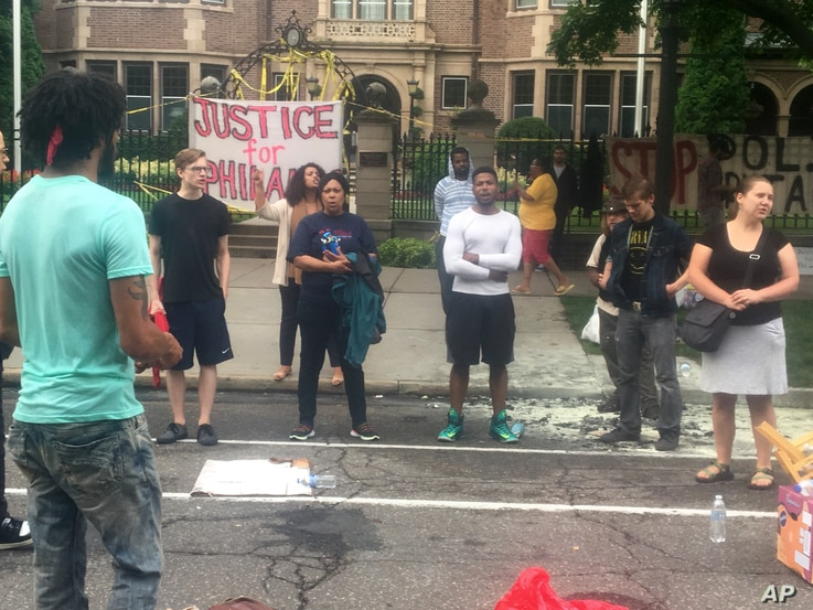 About 200 people gathered outside the Minnesota Governor's Residence in St. Paul on July 7, 2016 protesting the fatal shooting of a man by a suburban police officer.