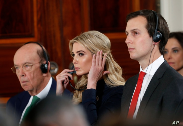 Commerce Secretary Wilbur Ross, Ivanka Trump and senior presidential adviser Jared Kushner listen during a news conference with President Donald Trump and German Chancellor Angela Merkel in the East Room of the White House in Washington, March 17, 20...