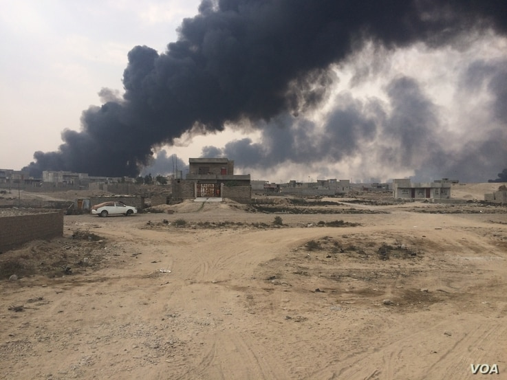 Just days ago, Islamic State militants were operating on the outskirts of Qayyarah setting fire to oil wells they controlled only a month ago, Oct. 24, 2016. (H. Murdock/VOA)
