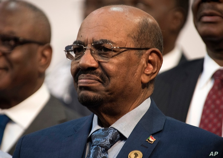 Sudanese President Omar al-Bashir is seen during the opening session of the AU summit in Johannesburg, June 14, 2015.