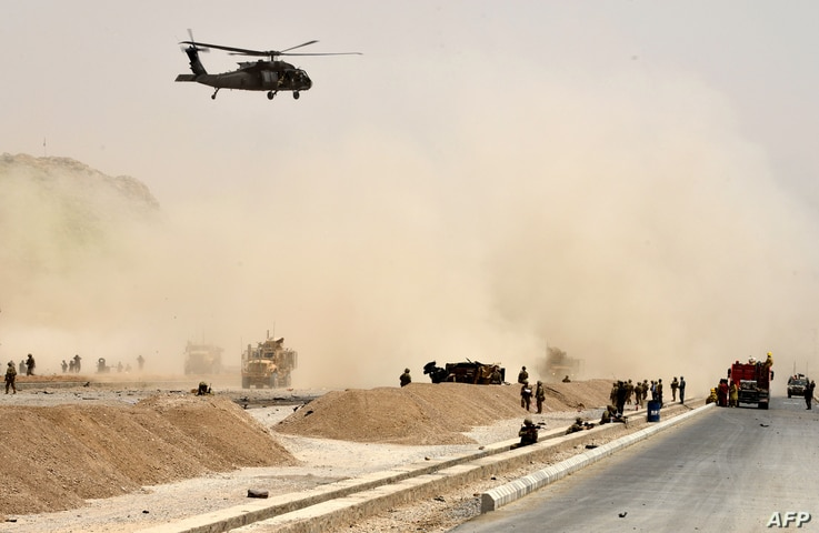 A U.S. black hawk helicopter flies over the site of a Taliban suicide attack in Kandahar, Afghanistan, Aug. 2, 2017.