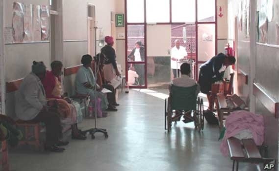 Patients, some of whom are disabled, wait to see doctors in a corridor at Zithulele Hospital. It's one of the few public health facilities in South Africa that employs physiotherapists
