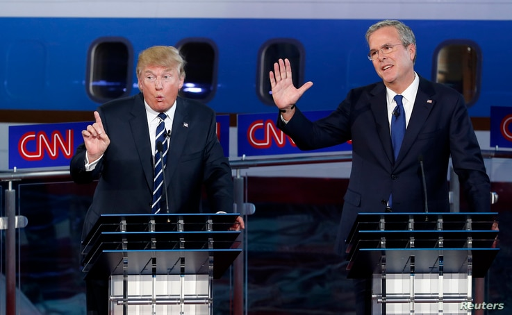 U.S. presidential candidate businessman Donald Trump speaks as former Florida Governor and fellow candidate Jeb Bush reacts during the second official Republican presidential candidates debate, Sept. 16, 2015.