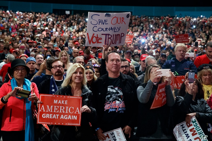 Supporters of Republican presidential candidate Donald Trump speaks during a campaign rally, Nov. 6, 2016, in Sterling Heights, Mich.