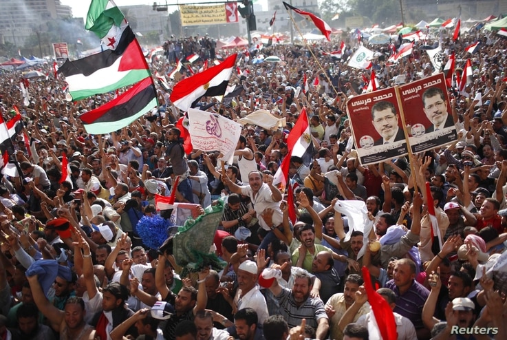 Supporters of Muslim Brotherhood's presidential candidate Mohamed Morsy celebrate his victory at the election at Tahrir Square in Cairo, June 24, 2012.