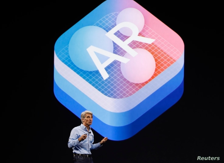 """Craig Federighi, Senior Vice President Software Engineering speaks about """"Augmented Reality"""" during Apple's annual world wide developer conference (WWDC) in San Jose, California, June 5, 2017."""
