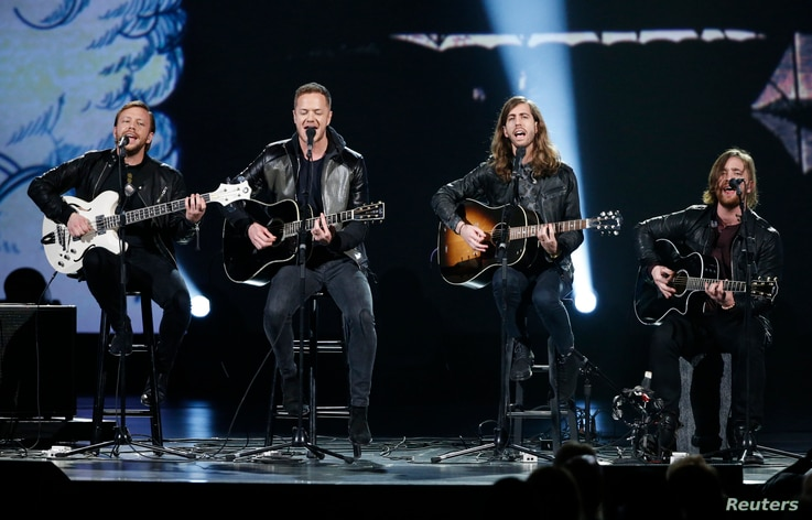 """FILE - Imagine Dragons performs during the taping of """"The Night That Changed America: A Grammy Salute To The Beatles"""", which commemorates the 50th anniversary of The Beatles appearance on the Ed Sullivan Show, in Los Angeles January 27, 2014."""