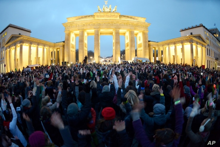 Participants gather in front of the Brandenburg Gate and dance for the 'One Billion Rising' movement, Berlin, Germany, Feb. 14, 2013.