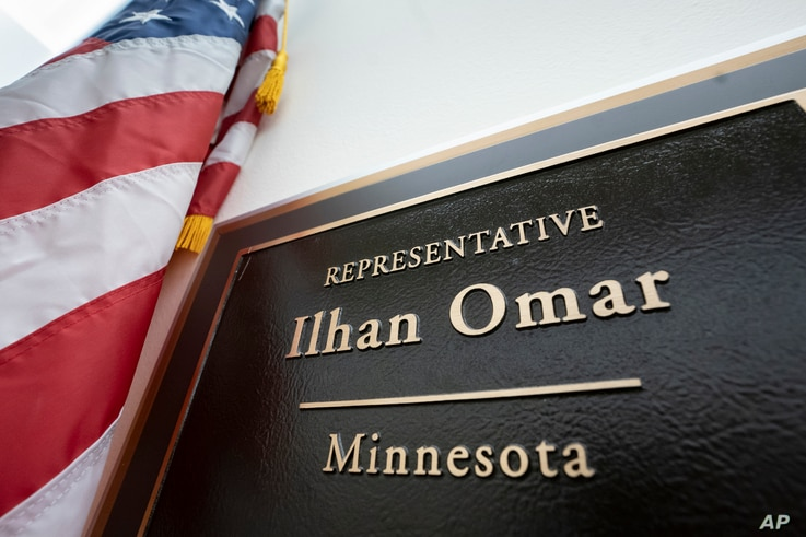 A sign marks the office of incoming Rep. Ilhan Omar, a freshman Democrat representing Minnesota's 5th Congressional District, in the Longworth House Office Building, on Capitol Hill in Washington.