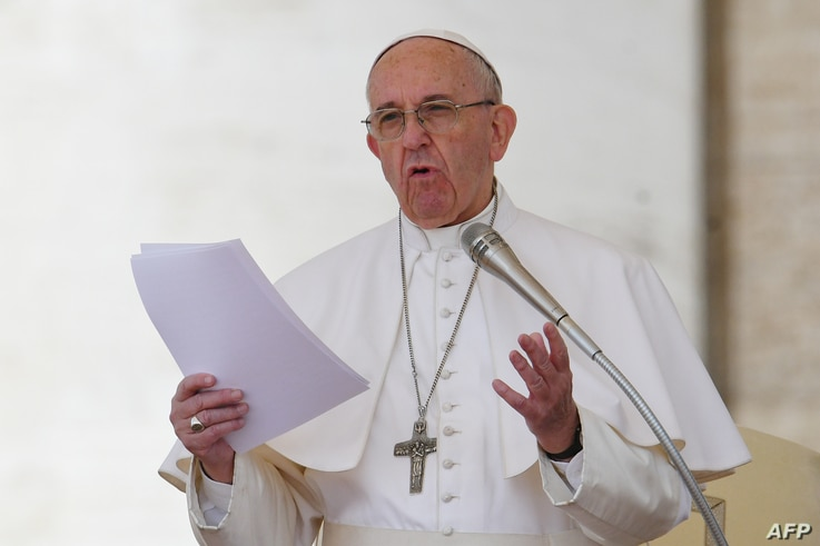 Pope Francis addresses the crowd during the Regina Coeli prayer at St Peter's square at the Vatican, April 30, 2017.