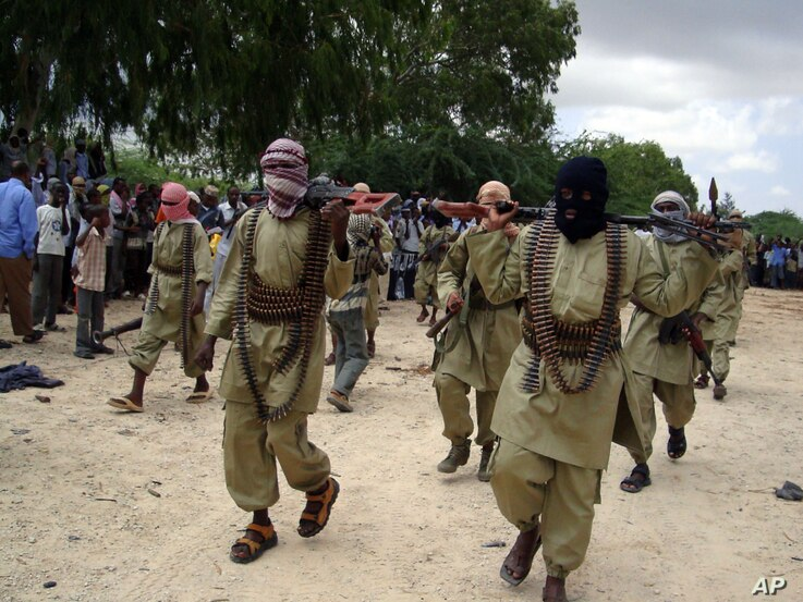 Al-Shabaab islamist fighters patrol to provide security to Somali demonstrators in Mogadishu, Friday, Oct. 30, 2009. The demonstrators  gathered in an open square north east of the capital Mogadishu to show their support for the Palestinian people. (