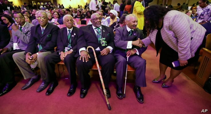 Five men who took part in the Memphis sanitation workers strike in 1968 wait for a ceremony to begin at the Mason Temple of the Church of God in Christ, Tuesday, April 3, 2018, in Memphis, Tenn.