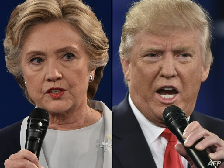This combination of pictures created on October 09, 2016 shows Democratic presidential candidate Hillary Clinton and Republican presidential candidate Donald Trump during the second presidential debate at Washington University in St. Louis, Missouri.