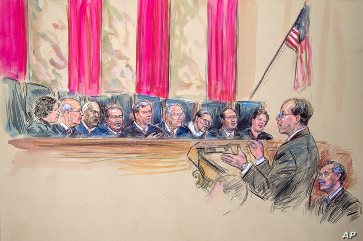 This artist rendering shows Paul Clement, second from left, with Solicitor General Donald B. Verrilli Jr. seated, right, addresses the Supreme Court in Washington, Wednesday, March 27, 2013, as the court heard arguments on the Defense of Marriage Act...