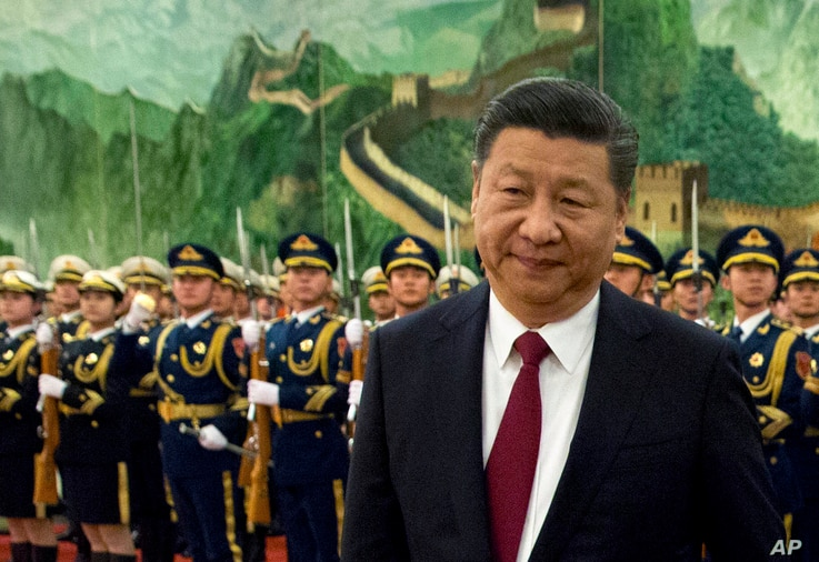 FILE - In this Tuesday, Jan. 9, 2018, file photo, Chinese President Xi Jinping reviews a Chinese honor guard during a welcome ceremony for a visiting dignitary at the Great Hall of the People in Beijing.