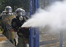 Riot police spray tear gas at demonstrators during clashes in Athens' Syntagma [Constitution] square, October 19, 2011.