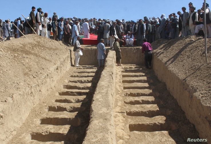 Graves are prepared for the burial of civilians killed by insurgents at Mirza Olang village, in Sar-e Pul province, Afghanistan, Aug. 16, 2017.