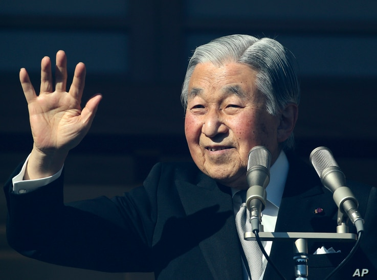 Japan's Emperor Akihito waves to well-wishers as he appears on the bullet-proofed balcony of the Imperial Palace in Tokyo, Dec. 23, 2017. Akihito marked his 84th birthday on Saturday with a pledge to fulfill his duties until the day of his abdication...