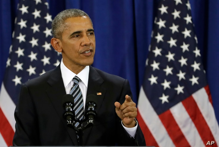 President Barack Obama gestures during a U.S. counterterrorism strategy speech at MacDill Air Force Base, in Tampa, Fla., Dec. 6, 2016.