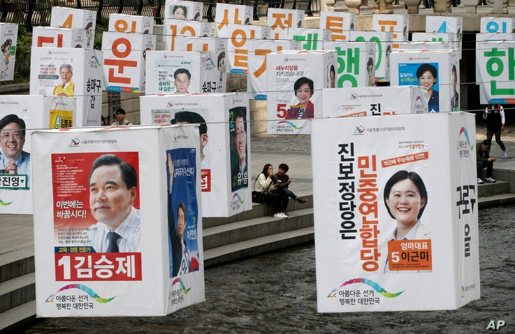Election posters of candidates for Seoul's constituencies in parliamentary election are hung on string over the Cheonggye Stream in Seoul, South Korea, April 13, 2016.