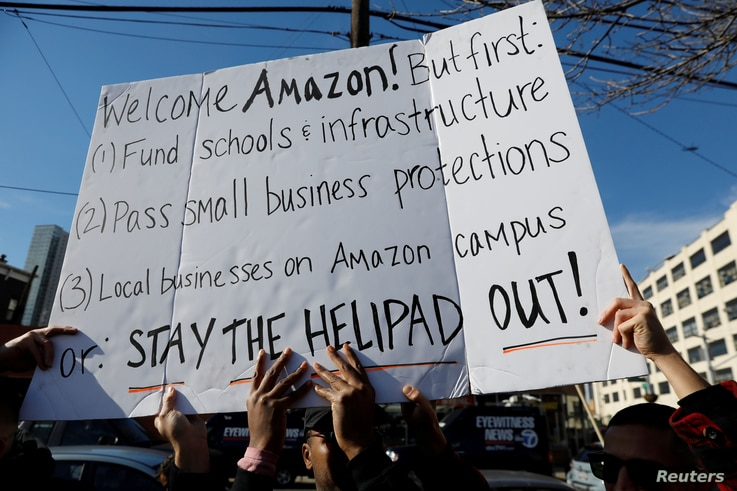FILE - Demonstrators gather to protest Amazon's headquarters location in Long Island City of the Queens borough of New York, Nov. 14, 2018.