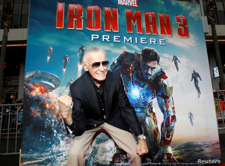 "FILE PHOTO: Stan Lee gestures as he poses at the premiere of ""Iron Man 3"" at El Capitan Theater in Hollywood, California, U.S., April 24, 2013."
