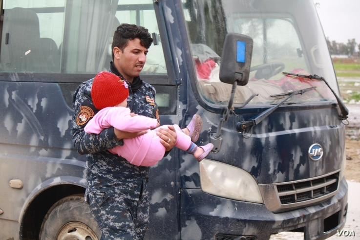 Iraqi forces drive families from the front lines to camps where they are registered and their names are checked against lists of known IS soldiers.  But as government and aid groups scramble to build more camps, families are pouring out of the wars z...