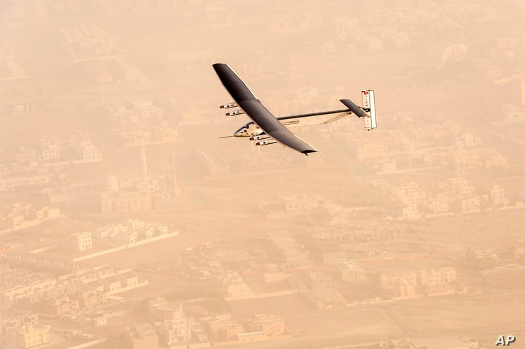 """In this photo released by Solar Impulse,  """"Solar Impulse 2"""", a solar-powered airplane flies after taking off from Al Bateen Executive Airport in Abu Dhabi, United Arab Emirates on Monday, March 9, 2015, marking the start of the first attempt to fly a..."""