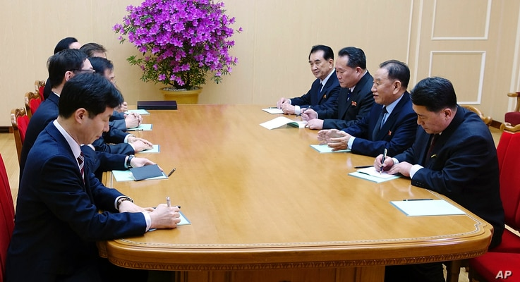 In this photo provided by South Korea Presidential Blue House via Yonhap News Agency, Kim Yong Chol, vice chairman of North Korea's ruling Workers' Party Central Committee, second from right, talks with South Korean delegation in Pyongyang, North Kor