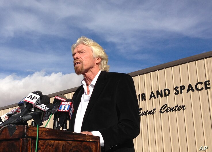 Virgin Galactic founder Richard Branson, speaking to reporters in Mojave, Calif., salutes the bravery of his company's test pilots, Nov. 1, 2014.