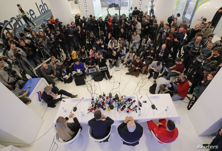 Chairman of the committee's Athletes' Commission, Sofya Velikaya, Russian Olympic Committee (ROC) President Alexander Zhukov, head of the national anti-doping commission Vitaly Smirnov and ice hockey player Ilya Kovalchuk attend a news conference fol...