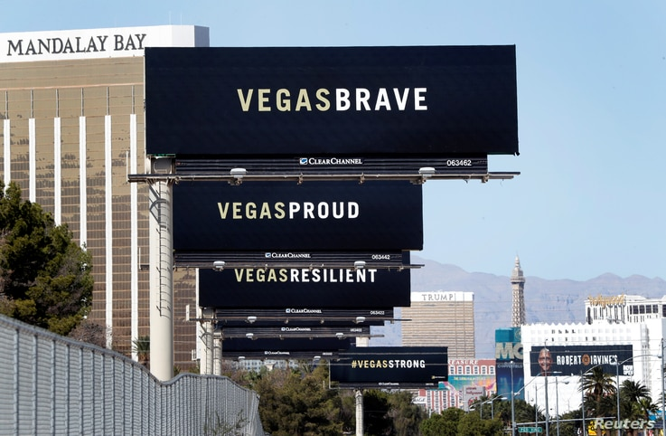 "Billboards are shown on Las Vegas Boulevard South near the ""Welcome to Las Vegas"" sign in Las Vegas, Nevada, Oct. 9, 2017."