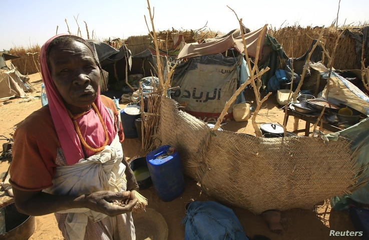 A woman looks on beside a shelter after arriving at the Zam Zam IDP camp, near Al Fashir in North Darfur, Sudan, April 9, 2015.