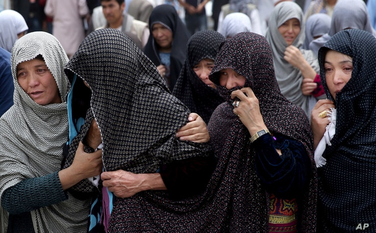 Afghan women mourn during the funeral of victims who died from a suicide attack, in Kabul, Afghanistan, Sunday, July 24, 2016.