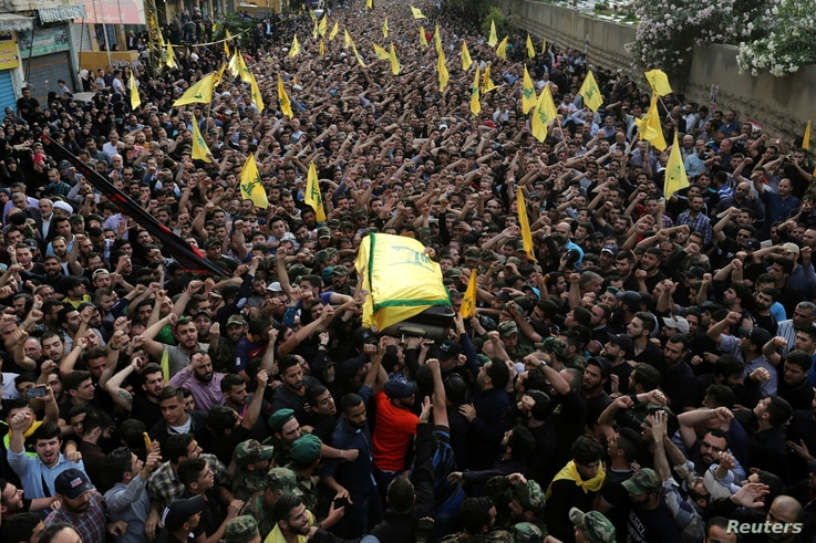 Hezbollah members carry the coffin of top Hezbollah commander Mustafa Badreddine, who was killed in an attack in Syria, during his funeral in Beirut's southern suburbs, Lebanon, May 13, 2016.