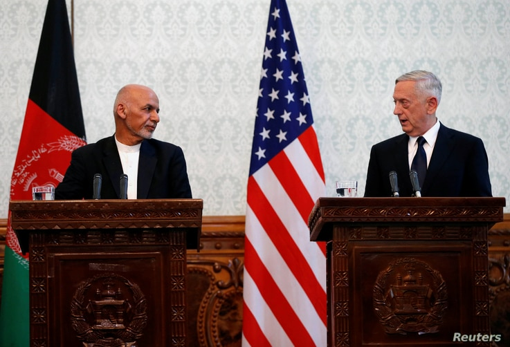 Afghanistan's president Ashraf Ghani, left, and U.S. Defense Secretary James Mattis, right, attend a news conference in Kabul, Afghanistan, Sept. 27, 2017.