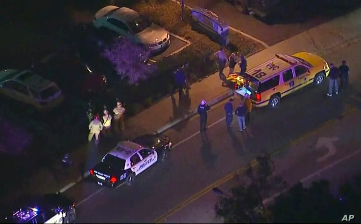 In this image made from aerial video, police vehicles line a road in the vicinity of a shooting in Thousand Oaks, California, early Nov. 8, 2018. Authorities say there were multiple injuries, including one officer, after a man opened fire in Southern...